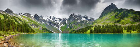 Mountain landscape, blue sky, forest and Lake Stock Photo