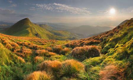 Fantastic mountain landscape. Mountains, blue sky, verdure.
