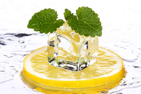 a slice of lemon, ice cube, mint leaves. The concept of freshness and coolness.