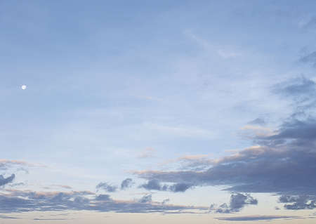 nebulosity: White clouds in the blue sky. Natural background. Stock Photo