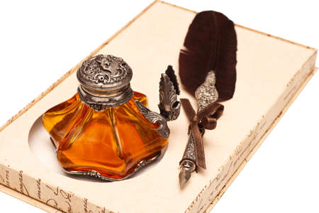 Antique Feather and Inkwell. Isolated on white background Stock Photo