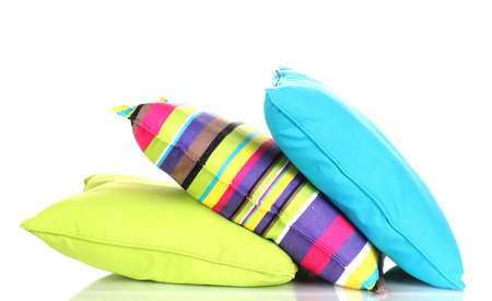 A stack of colorful pillows isolated on white background