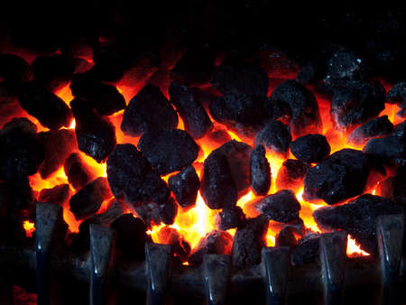 hellish: Burning Coal. Heat. The extinct fire. BBQ, fireplace. Stock Photo