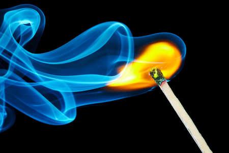 burning match with the smoke. Isolated on black background Stock Photo