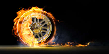 burnout: Car racing spinning wheel burns rubber on fire.