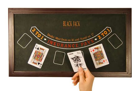 seven persons: Hand lays out playing cards on the table Stock Photo