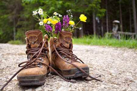 Hiking boots with water bottle Stock Photo