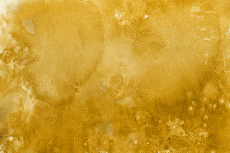Gold watercolor texture paper. Abstract background.