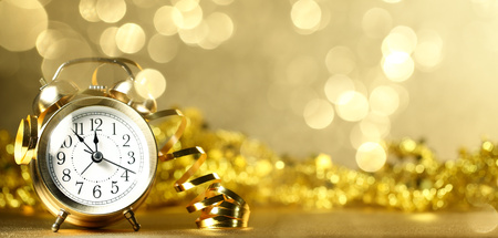 Vintage watch on a festive background showing five to midnight Stock Photo