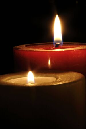 Two burning candles with a dark background. Stock Photo - 2848588