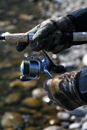 Angler holding fishing rod photo