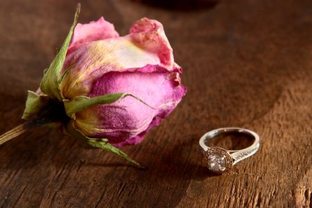 Diamond ring and dried rose.
