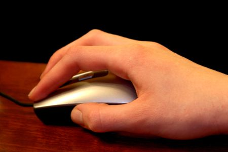 Hand holding mouse. Stock Photo