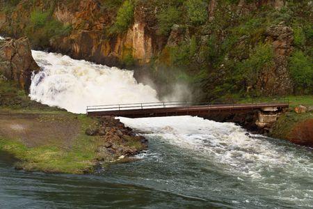 Bridge Under Waterfall