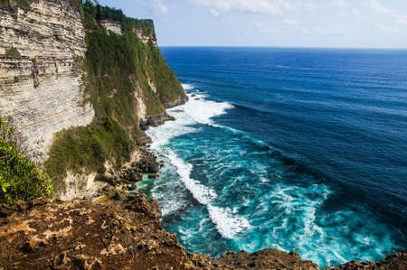 tropica: The cliffs and the ocean near the Uluwatu Temple on Bali, Indonesia. Stock Photo