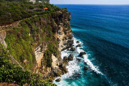 tropica: Cliffs and ocean near Uluwatu Temple on Bali, Indonesia Stock Photo