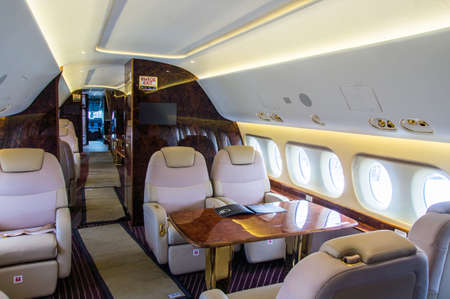 Luxury interior of genuine leather in the modern business jet 免版税图像