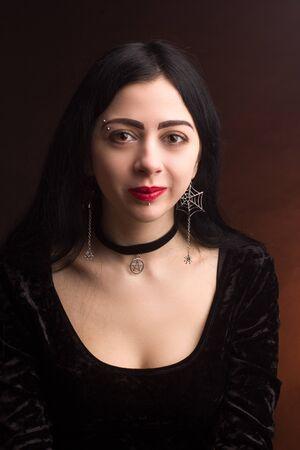 brunette on dark Studio background dressed in goth style Reklamní fotografie