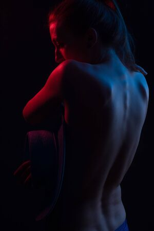 Fashionable Artistic Portrait Of A Beautiful Female Model In Bright backlit. back is worth