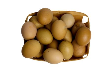 chicken eggs brown eggs in a wicker tray. isolated on white