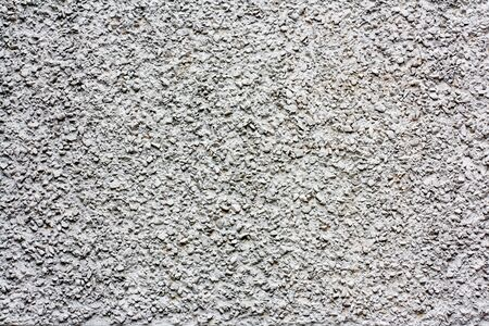 Gray concrete wall of a prefabricated house. Concrete and stone.