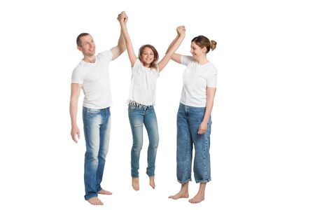 family mom, dad and son, in casual clothing, isolated on a white background