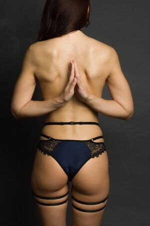 Unrecognizable fit woman in blue lingerie. Body care, healthy and sporty life concept