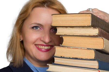 plus size caucasian business office woman. isolated in white. looks out from behind a stack of books. The concept of adult learning