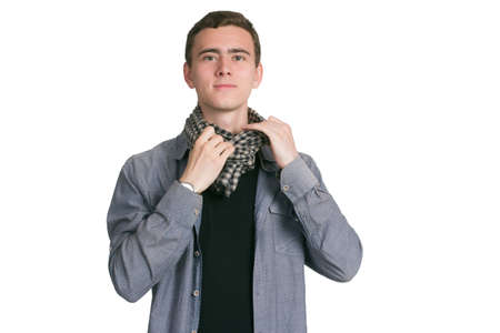 A young man in a Manatee shirt, black t-shirt and trousers, isolated on white. dresses, ties a checkered scarf