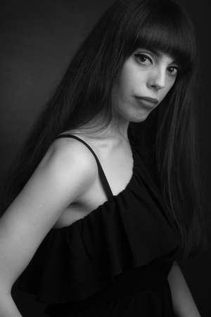 black and white portrait of brunette with long hair, off shoulder Banco de Imagens