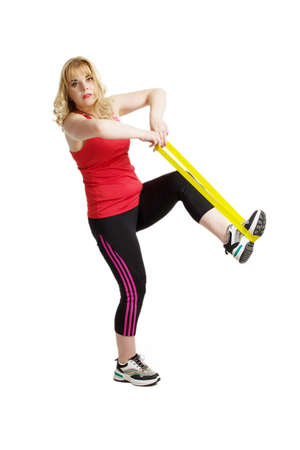 A blonde woman with overweight, engaged in sports or fitness. Isolate on a white background