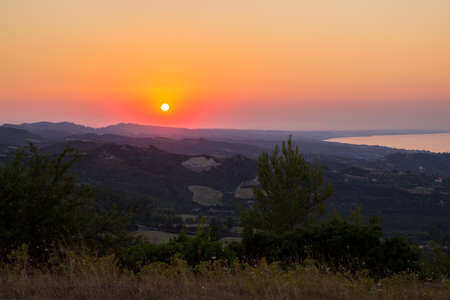 Sunset in Greece in the mountains overlooking the sea