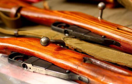 Old bolt rifles background Stock Photo