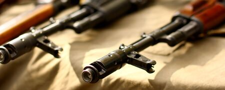AK47 Rifle on a White on military background 版權商用圖片