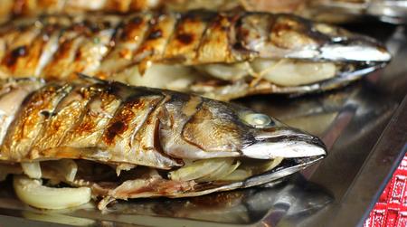 stuffed fish: Smoked fish stuffed with onion street fast food grill restaurant Stock Photo