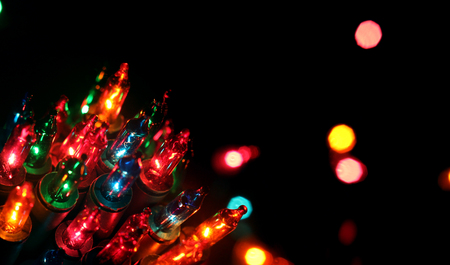 celebrat: Christmas, New Years garland colorful lights in night with bokeh dark background with copyspace for text. Stock Photo