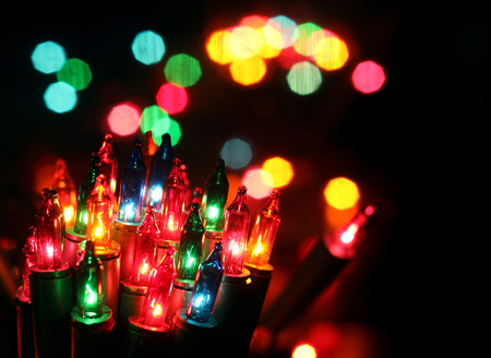 celebrat: Christmas, New Years garland colorful lights in night with bokeh dark background