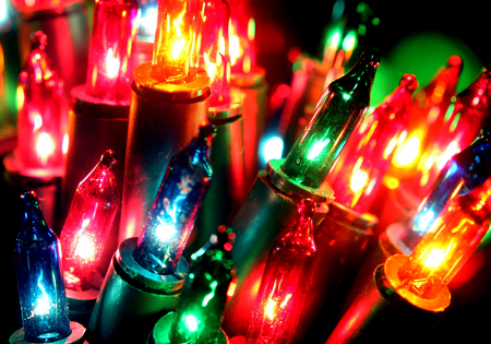 celebrat: Close up Christmas, New Years garland colorful lights with bokeh dark background