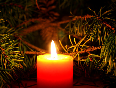 romantic: Christmas desktop wallpaper with candles with New Yera`s tree brunch on dark background Stock Photo