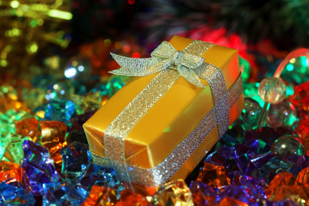 midnight: Christmas and New Year`s decorations and present boxes gold wrapping paper with bows of silver ribbons. Greeting card blue Background with holiday tinsel.