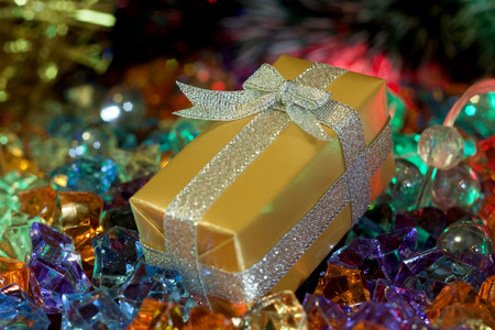 illustrati: Christmas and New Year`s decorations and present boxes gold wrapping paper with bows of silver ribbons. Greeting card blue Background with holiday tinsel.
