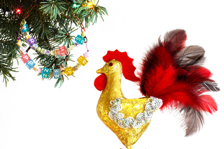 happy new year banner: Happy New Year 2017 of rooster card with hand made craft gold rooster and beaded letter garland on fir Christmas tree branch isolated on white background. Copyspace place for your text.