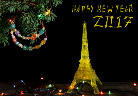 happy new year 2017 card with gold yellow model of the eiffel tower in paris old