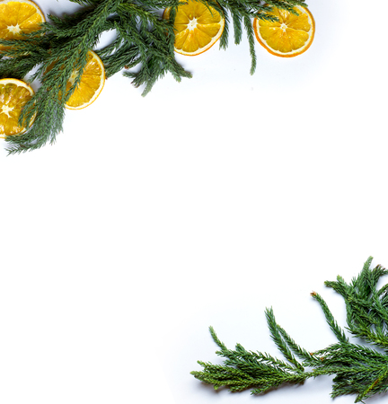 market bottom: Christmas diagonal top and bottom corners border frame of fir tree branch, dry oranges fruit. New Year`s background for card, market winter sale banner or poster with copyspace for text. Isolated. Stock Photo