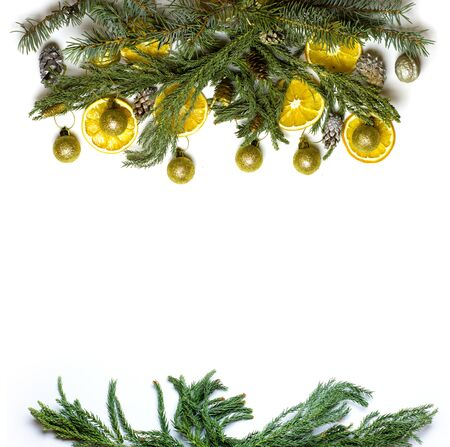 market bottom: Christmas top and bottom border frame of fir tree branch, golden pine cones and balls, dry oranges fruit. New Year`s background for card, market winter sale banner or poster with copyspace for text..