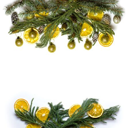 market bottom: Christmas top and bottom border frame of fir tree branch, golden pine cones and balls, dry oranges fruit. New Year`s background for card, market winter sale banner or poster with copyspace for text.