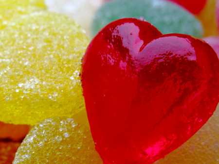 A beautiful red heart candies coated with sugar.  Love colorful sweet candies, hearts shaped candy 14 february