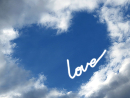 Sky, clouds, forming a heart shape. Love inscription. Stock Photo