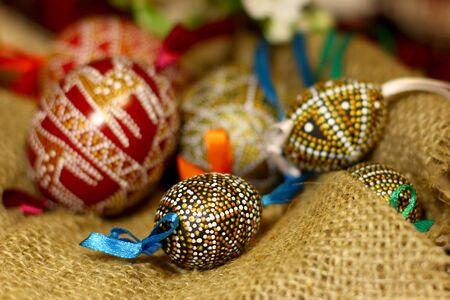 orthodoxy: Handmade Easter eggs on coarse burlap cloth background Stock Photo