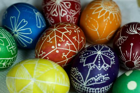 Handmade colored Easter eggs on traditional cloth background Stock Photo